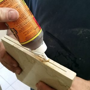 Gluing your shower shelf