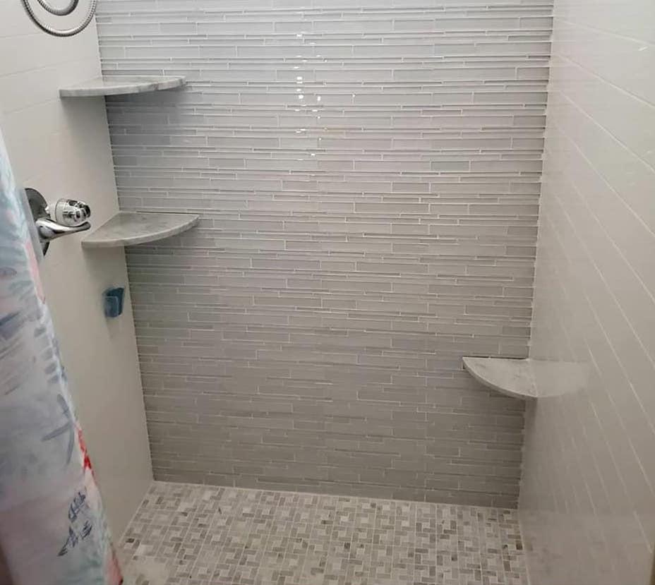 corner shower foot rest