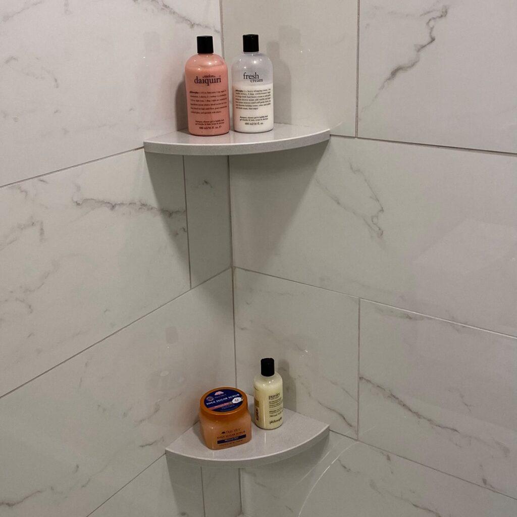 floating shelves on tile wall
