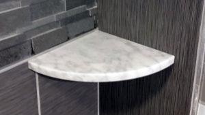 white marble shower shelf